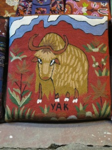I have no photos to accompany this post. So, for your viewing pleasure, I have posted this photo of a Yak Pillow waiting to be adopted into a loving home, outside a Pokhara shop.