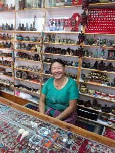 "Tsogyal (meaning ""Lake Queen"") is the proprietress of this new Tibetan handicraft shop."