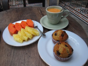 Breakfast. Fresh papaya and pineapple, a strong Thai-style tea, and banana chocolate-chip muffins.