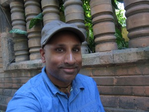 Selfie with terra cotta background.