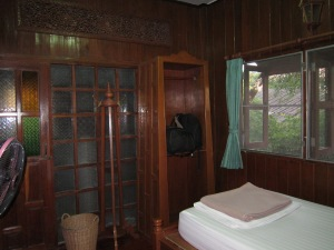 My teak paneled room at the Ban Thai Guest House.