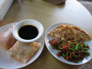 Shredded veggies wrapped in rice paper; roti and green beans with soy protein.