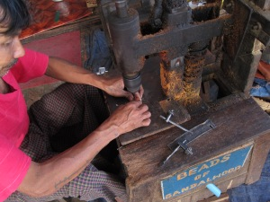 Craftsman making sandalwood beads, Mandalay Hill.