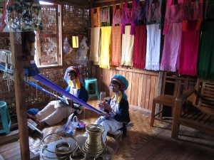 Kayan women weaving their traditional textiles.