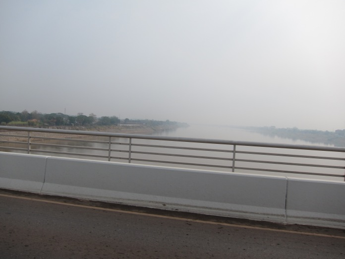 Crossing the Mekong River from Thailand to Laos.