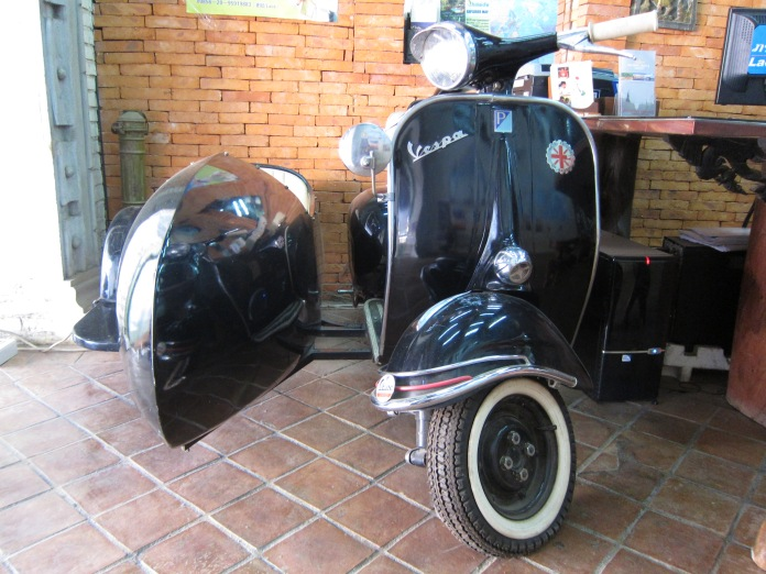 Old Vespa with sidecar.