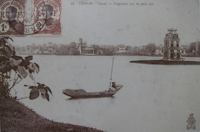 Image of an old postcard of Hoan Kiem Lake, from a display of old photographs near the lake.